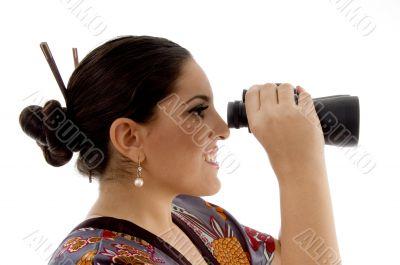 side pose of female watching through binocular
