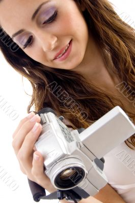 professional woman looking video into handy cam