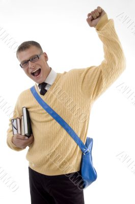 happy young student standing with books and bag