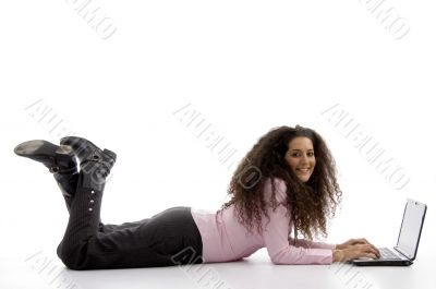 young hispanic female busy working on laptop