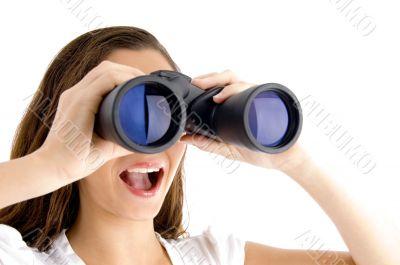 close up of female watching through binocular