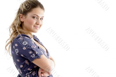 side view of smiling young girl with crossed arms