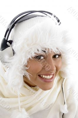 girl wearing winter clothes and listening to music