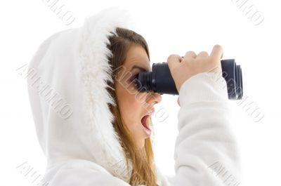 astonished female watching through binocular