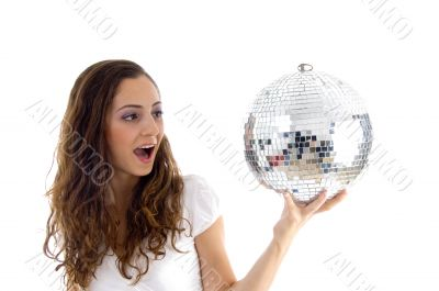 female holding mirror ball with one hand