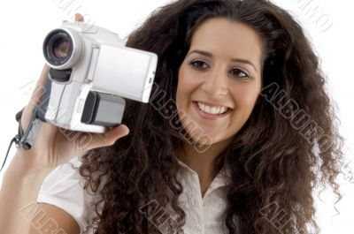 young photographer making video with handy cam