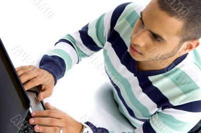 teenager guy working on laptop