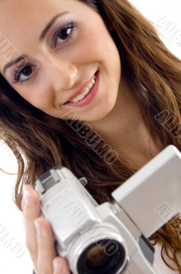 young female holding handy cam