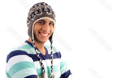 smiling boy covering his head with woolen cap
