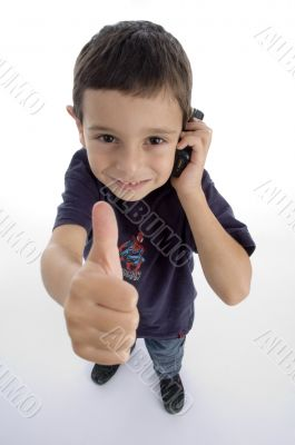 boy busy on phone call and showing thumbs up