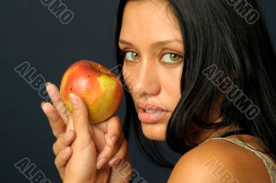 Beautiful exotic woman with apple