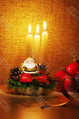 Santa in candles light and christmas ball