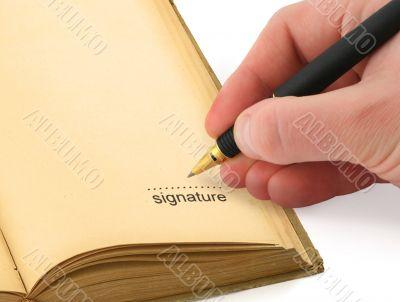 hand writing a signature