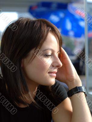 cute girl outdoor side view portrait hands on head