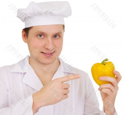 Cook with yellow paprica in hand