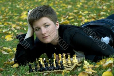 Charming woman with the chess board