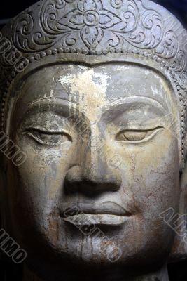 Asian statue facial closeup