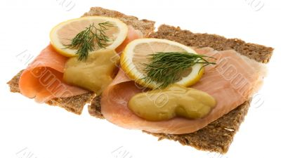 Salmon garnished on wholemeal bread