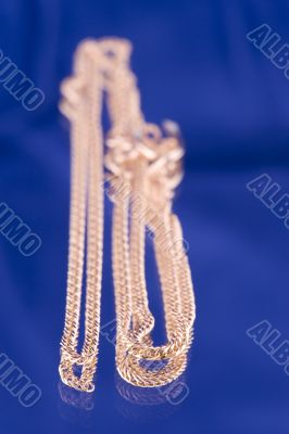 Golden chain on blue