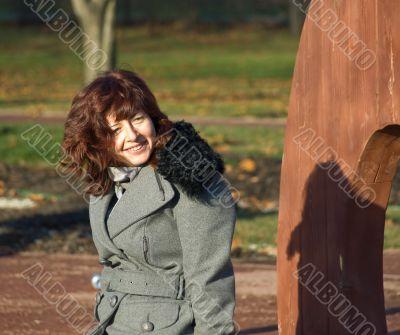 Joyful young woman in the autumn garden