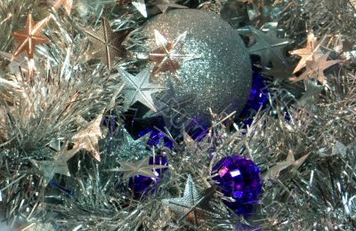 Silver and purple cristmas balls and stars garlands
