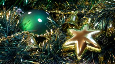 Green cristmas ball and golden star