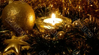 Golden xmas ball in candle light