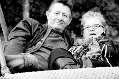 Older couple on the swing