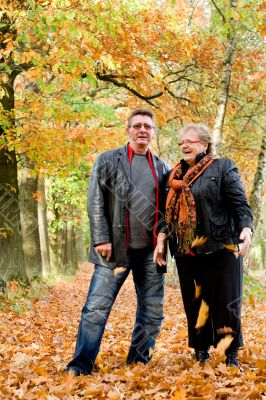 Happy older couple in the autumn