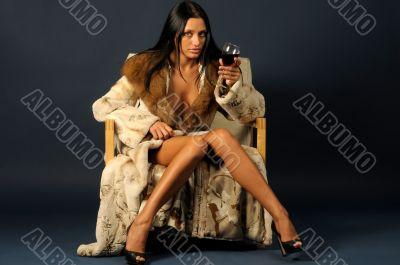 woman in furs witn wine.