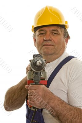 Worker with drilling machine and safety helmet