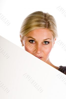 pretty woman holding a blank over white background