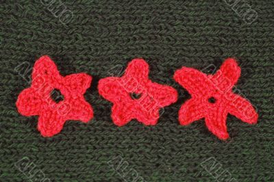 green wool material with ornament