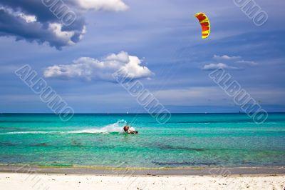 kitesurfer and white sandy beach