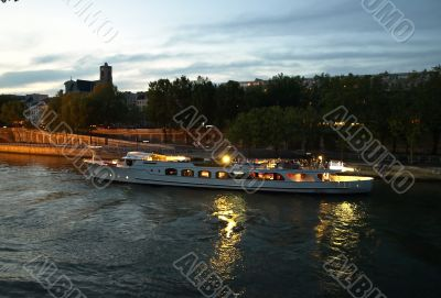 Pleasure craft on Seine, Paris, at night