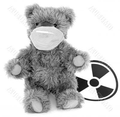 Toy baer and sign to radiation