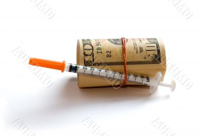 A roll of dollars with syringe