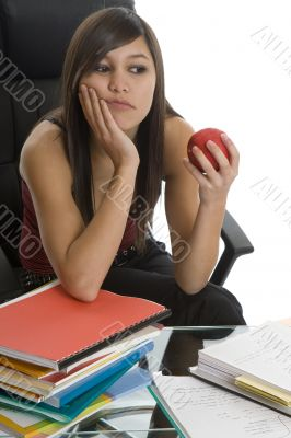 Female student when studying with apple