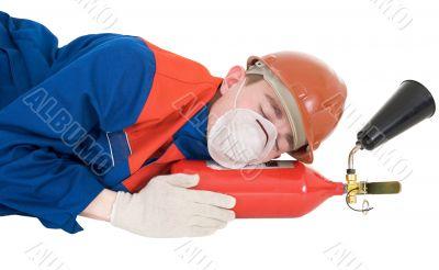 Sleeping laborer with fire extinguisheron