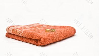 Orange towel and cuff links