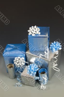stock of blue and silver wrapped christmas presents with ribbons
