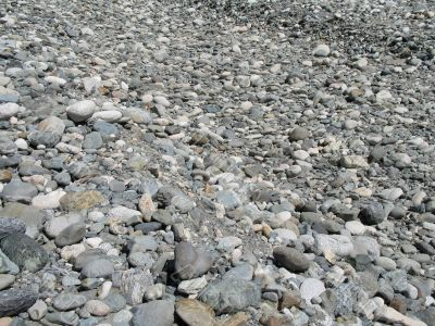 a gray pile of rounded rocks