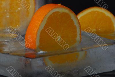 composition of frozen oranges in block of ice
