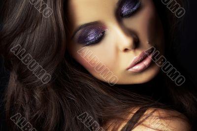 beautiful and sexy brunette girl on dark