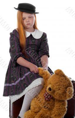 Sad travelling redhead girl