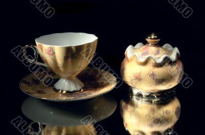 Cup and sugar bowl.