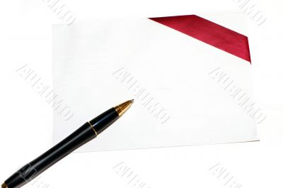 Diagonal red gift bow and blank card on white background