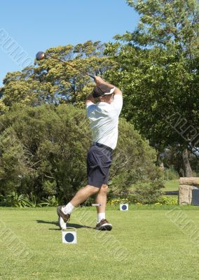 Golfer hitting the ball off the tee box