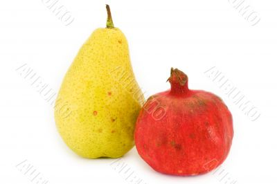 Pear and pomegranate isolated on white background
