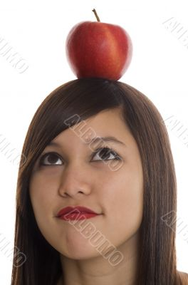 Teenager with apple at the head
